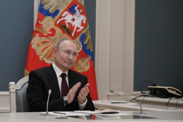 """Russian President Vladimir Putin participates via video link in a ceremony launching a gold processing facility in Kyrgyzstan, in Moscow on March 17, 2021. Putin said he wishes Biden """"Be Healthy!"""" and challenged Biden to a live, no-delay debate in response to the U.S. President's strong language towards Moscow."""