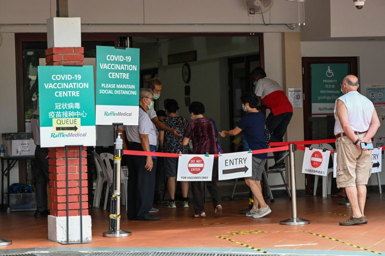 singapore-covid-19-vaccination-centre_GettyImages-1235740167